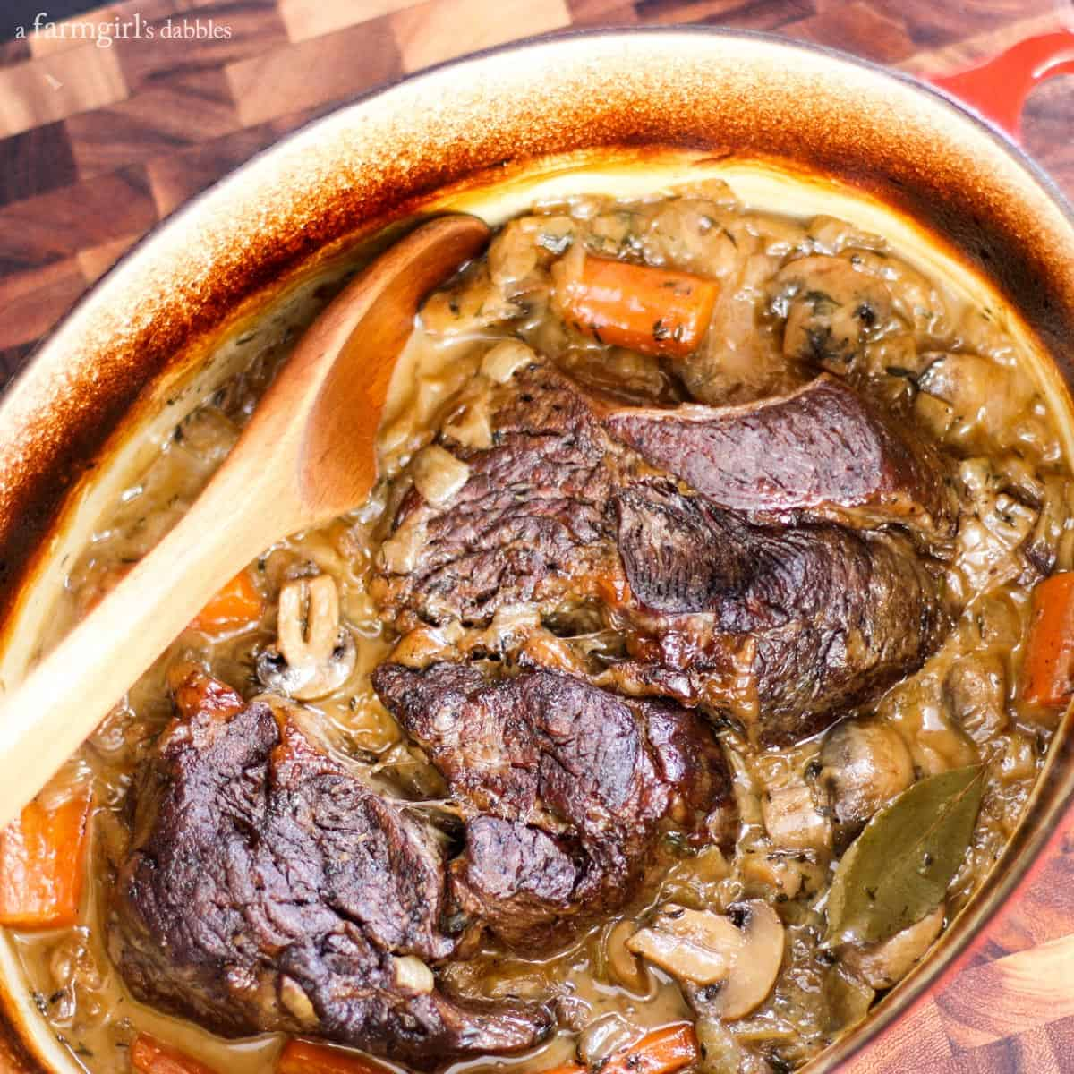Hard Cider Pot Roast with Mushrooms, Carrots, and Onions from afarmgirlsdabbles.com