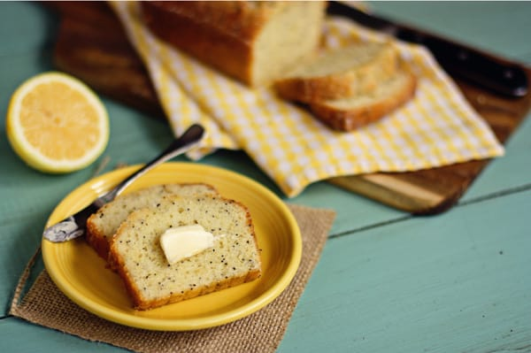 A Slice of Almond Poppy Seed Bread with Butter on Top