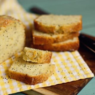 Almond Poppy Seed Bread on a Yellow Checkered Dish Towel