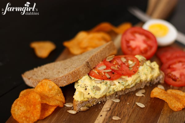 and herby egg salad sandwich and tomato slices