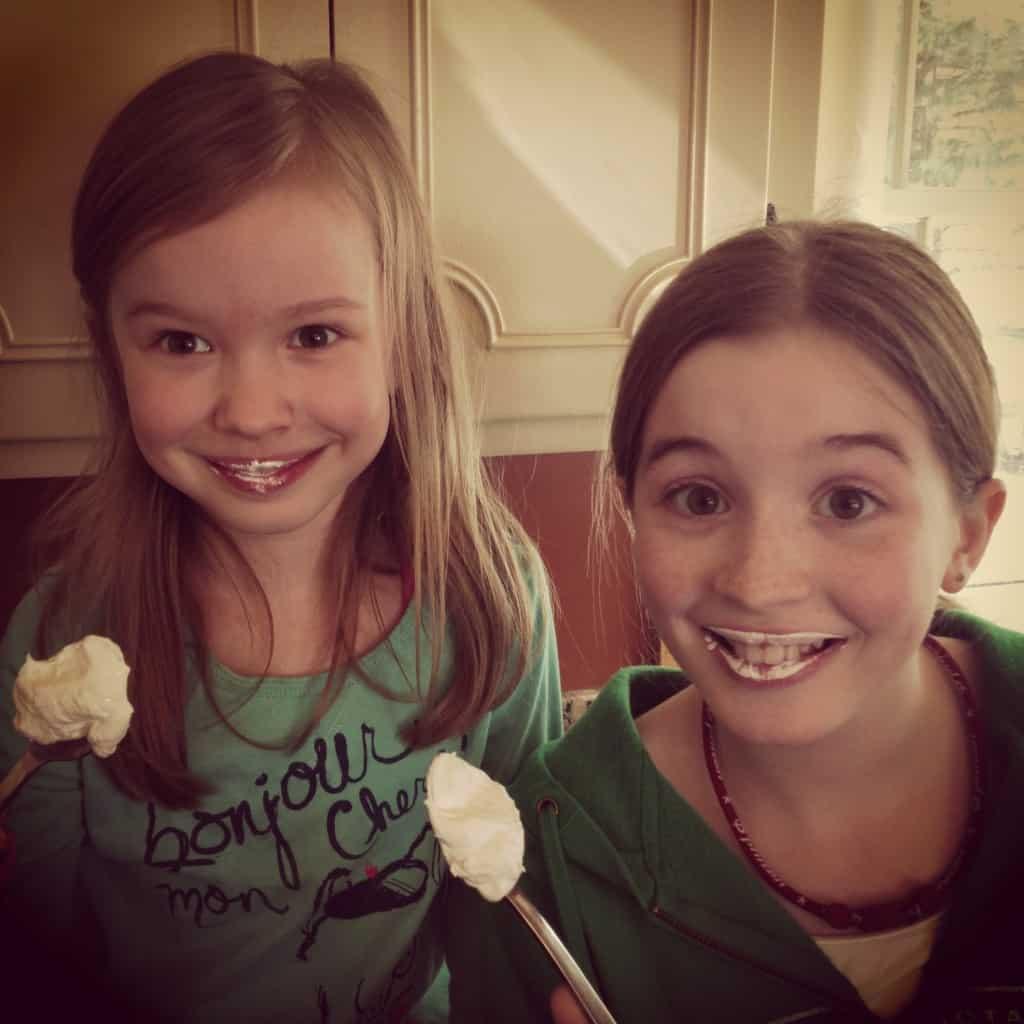 two girls eating marshmallow cream