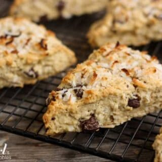 Scones with chocolate chunks and coconut on a cooling rack