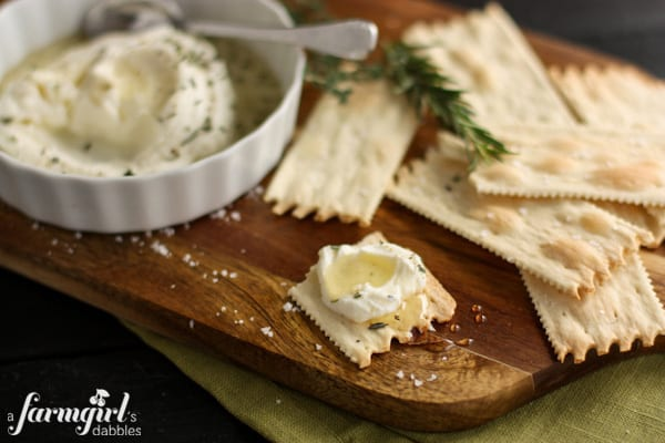 ricotta and honey spread on a cracker