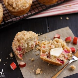 a Rhubarb Muffins sliced in half spread with butter