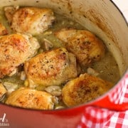 a red crockpot of Braised Chicken with Mushrooms and Green Olives