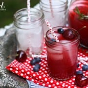 a pitcher of Sangria with cherries and blueberries