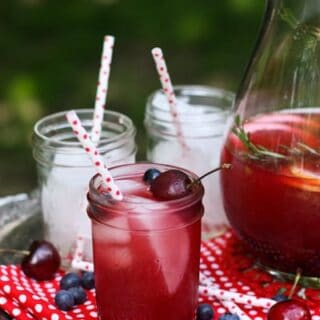 mason jars of rosé and bourbon Sangria