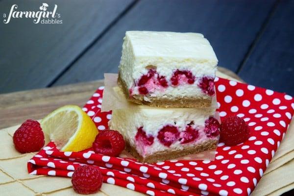 Lemon Cheesecake Bars with Raspberries - www.afarmgirlsdabbles.com