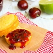 a cornbread muffin with Cherry Jam spread on top