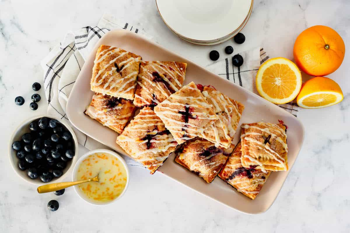 Square blueberry hand pies on a serving platter