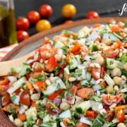 a large pottery bowl of Mediterranean Chopped Salad