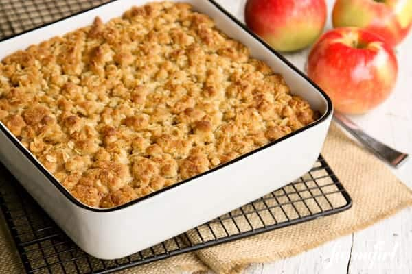 a white baking pan of Apple Oatmeal on a cooling rack