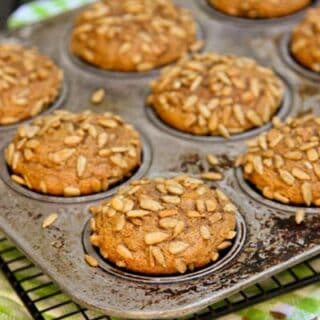a pan of Pumpkin Muffins on a cooling rack