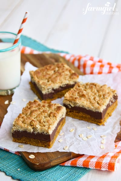 three Pumpkin fudge bars with a glass of milk