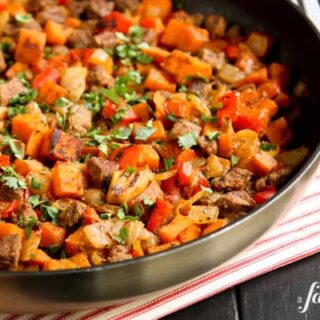 A skillet of beef and sweet potato hash