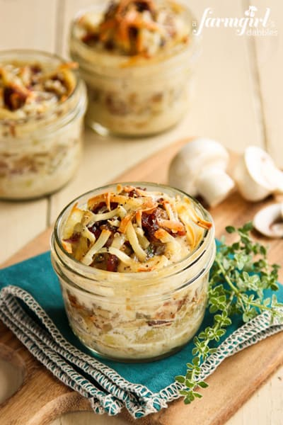 Individual glass jars of Potato Gratins topped with Bacon and Mushrooms