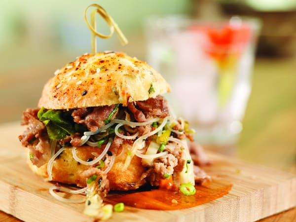 Shaved Pork-Umms sandwich with scallion, sesame BBQ, and kimchee biscuit