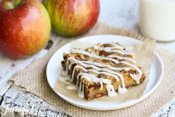 a slice of an Apple Bar with whole, fresh apples