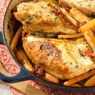 chicken breasts, hard cider, parsnips in a dark blue casserole dish