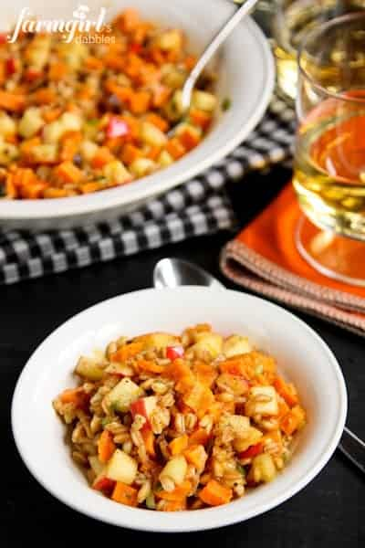 Farro Salad with Sweet Potatoes, Apples, and Chestnuts in a white bowl