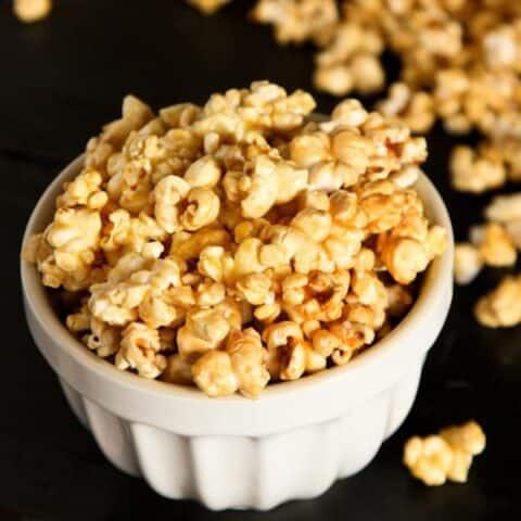 caramel popcorn in a white dish
