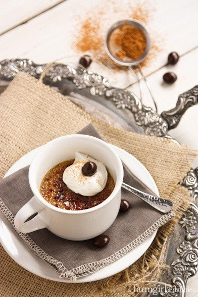 Cappuccino Crème Brûlée in a white teacup and topped with whipped cream