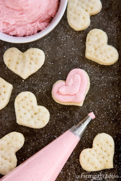 Cream Wafer Sandwich Cookies with Strawberry Buttercream - afarmgirlsdabbles.com