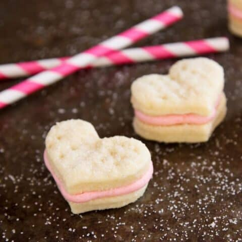 Heart-shaped sandwich cookies with strawberry buttercream filling