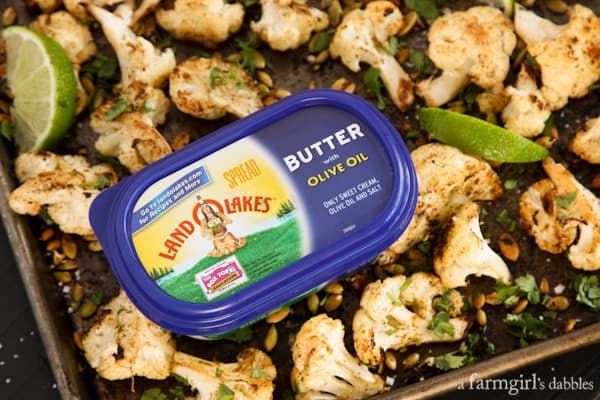 a tub of butter with roasted cauliflower