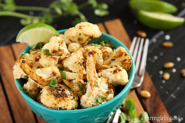 Roasted Cauliflower with Pepitas in a blue serving bowl