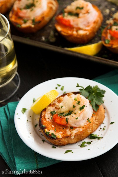 a glass of white wine and a sriracha shrimp toast