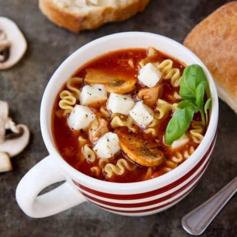 a white mug of chicken lasagna soup