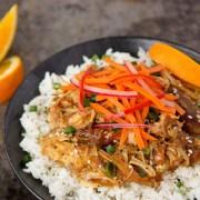 orange chicken and vegetable rice bowl