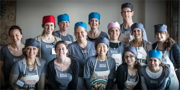 A Group of Bakers Posing Together in Aprons