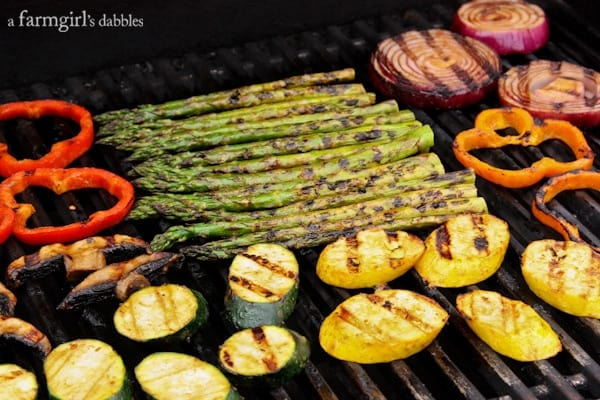 a variety of vegetables on the grill