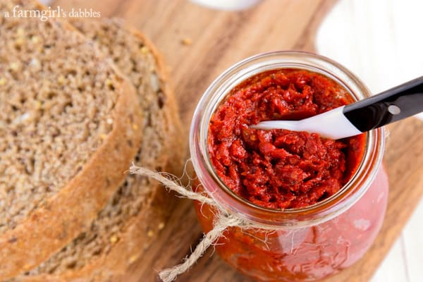 while grain bread and a jar of Tomato Spread