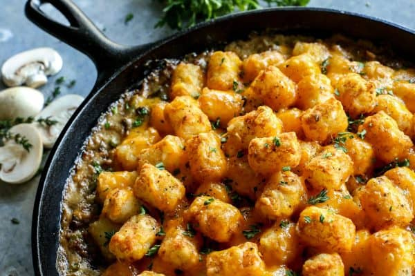 Tater Tot Hotdish {2 ways...with and withOUT canned soup!} from afarmgirlsdabbles.com - Tater Tot Hotdish is a classic comfort food meal here in Minnesota. This casserole is my tried and true recipe, featuring two different ways to make it - with and withOUT canned soup! #hotdish #casserole #tatertot #tatertots #onepan #cheese #beef #gravy #comfortfood