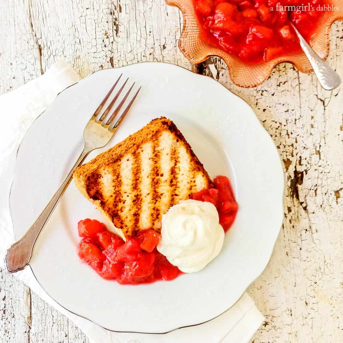 Grilled Angel Food Cake with Mom's Super Simple Rhubarb Sauce from afarmgirlsdabbles.com