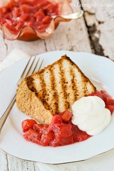 Grilled Angel Food Cake with Mom's Super Simple Rhubarb Sauce - afarmgirlsdabbles.com #rhubarb #angelfoodcake #grilling