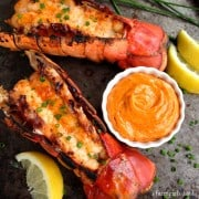 Grilled Lobster Tails with a dish of Sriracha Butter