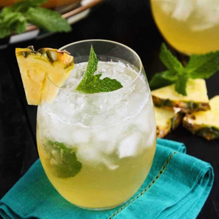 a glass of pineapple mint julep sangria