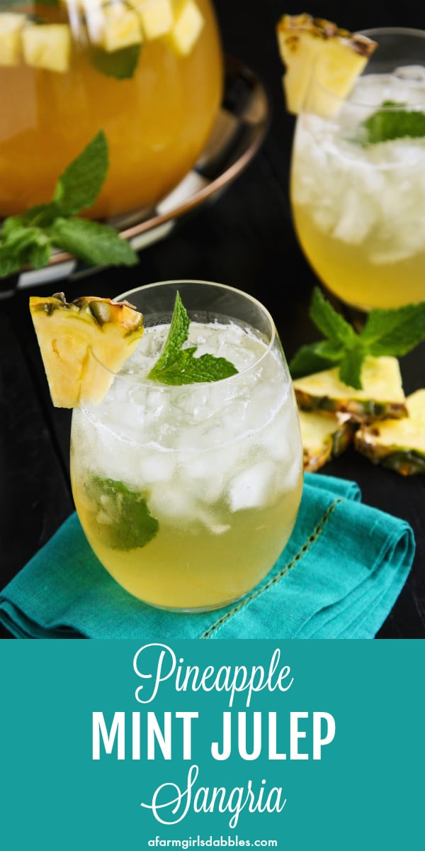 Pineapple Mint Julep Sangria from afarmgirlsdabbles.com - A fun twist on the traditional mint julep beverage served at the Kentucky Derby each spring, and perfectly refreshing all summer long - pineapple juice, fresh mint, crisp white wine, and a splash of Bourbon make a refreshing cocktail! #mint #julep #cocktail #pineapple #bourbon