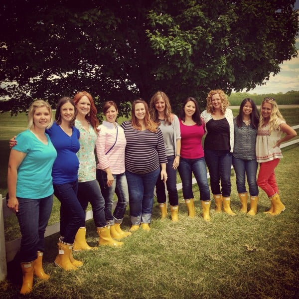 a group of women in yellow rain boots