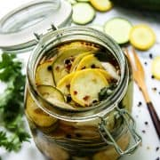 slices of squash pickles in a jar