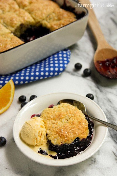 Blueberry Cobbler in a white bowl with vanilla ice cream