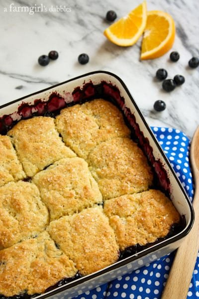 a square baking pan of Blueberry Cobbler topped with Orange Biscuits