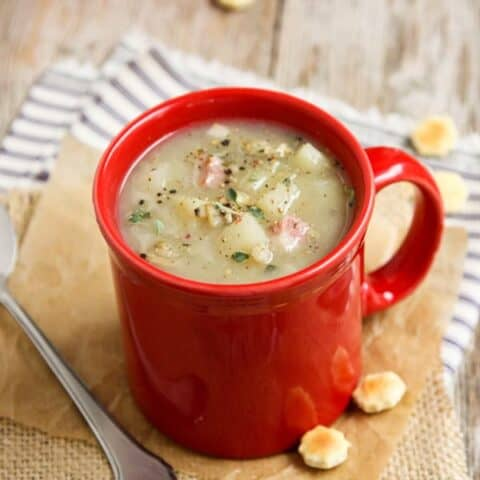New England Clam Chowder in a Red Mug with Oyster Crackers
