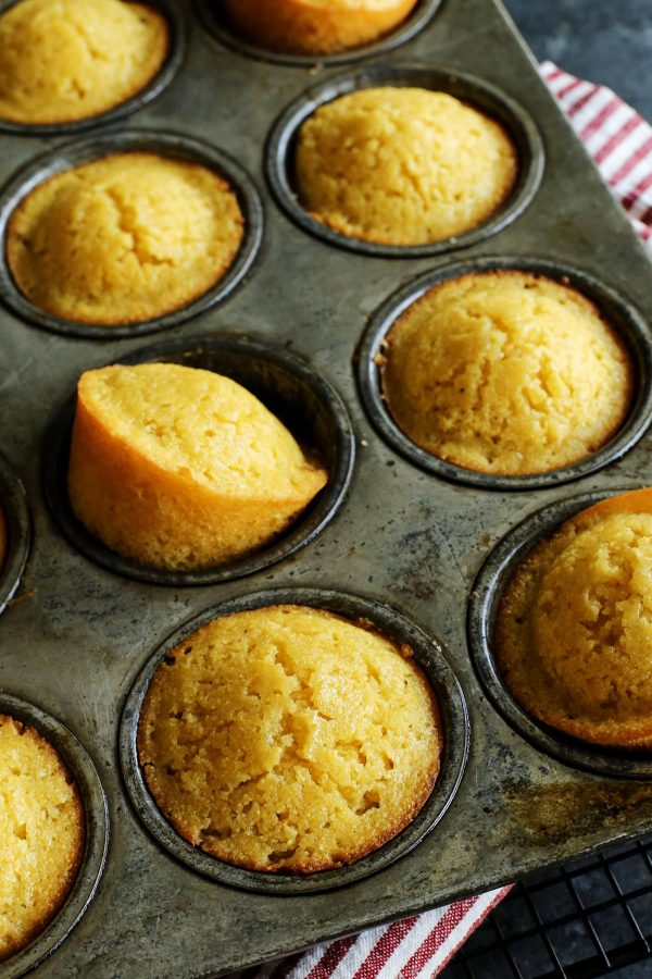 Honey Cornbread Muffins from afarmgirlsdabbles.com - These cornbread muffins are slightly sweet, with a moist cake-like crumb from buttermilk and butter in the batter. #cornbread #muffins #muffin #honey