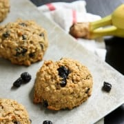 Peanut Butter Banana Breakfast Cookies with blueberries on a parchment-lined baking sheet