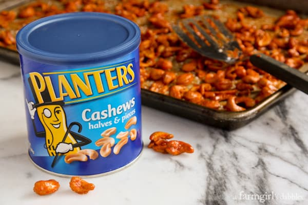 planters cashews and a pan of Candied Sriracha Cashews